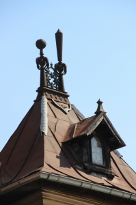 a roof; note the cute couple of man and wife