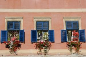 three windows, also flower-filled, in Sibiu