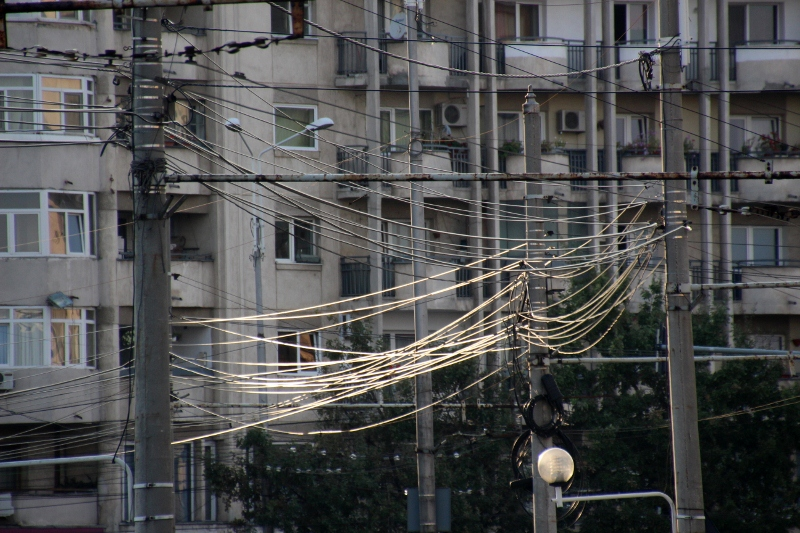 cables in Ploiesti still mostly run outside, in between poles
