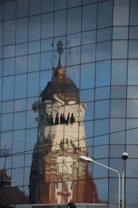 the church, reflected in a modern office building