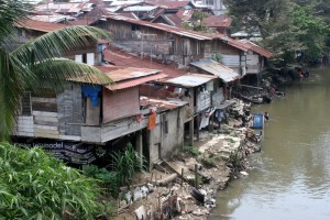 not all of Medan is big-city-like, here houses along the river