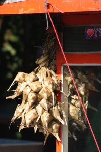 sticky rice parcels on a food stall in Medan
