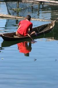 fisherman on Danau Maninjau, a crater lake on Sumatra