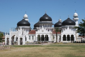 no less than seven domes and eight minarets, added over time