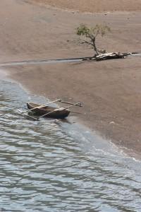 fishing canoe along the beach