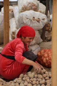 market woman with potatos