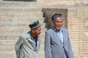 the men in front of the Mir-i-Arab madrasse