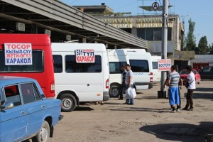 marshrutkas lined up for various destinations in the bus station