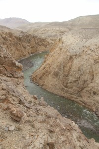 here the Pamir River looks more like a border, flowing through a steep gorge