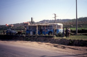 an old bus, turned into a bar-bufet along the road