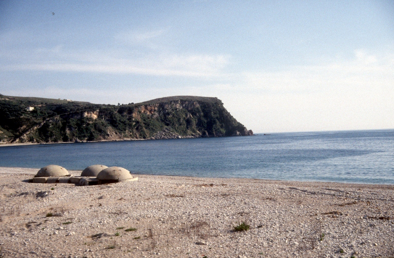 the beach south of Himara, with view of the peninsula