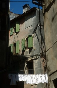 the typical, green shutters and white laundry