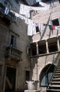 columned apartments in the palace, mundane laundry