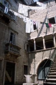 columned apartments in the palace, mundane laundry
