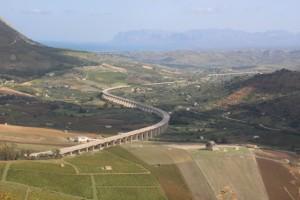 a motor way snaking through the Sicilian landscape