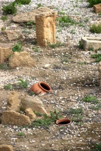 tomb stone and urns in the Phoenecian cemetery of Monzi