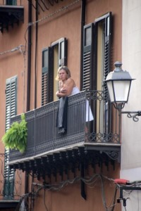woman watching the world from her balcony
