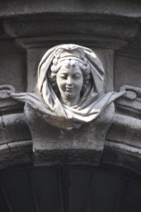 and a face above the door