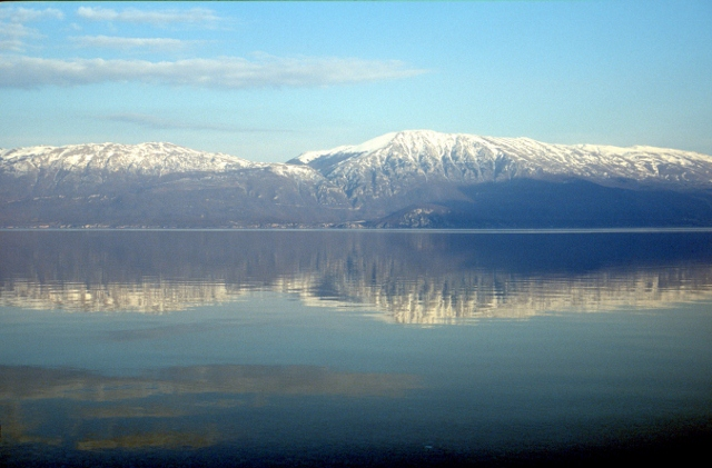 Lake Ohrid and snowy mountain slopes all around