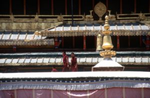 young monks on the roof of the Samye monastery