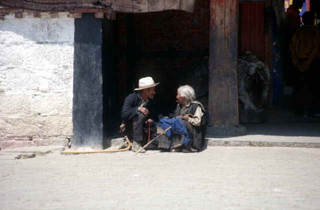 two people debating, in front of the Samye monastery