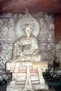 sculpture and image in one of the Bei Shan caves