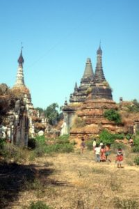 children playing in between the deserted pagodas