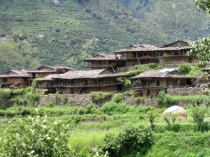 a wooden village on the road to Manali (courtesy Gijs Remmelts)