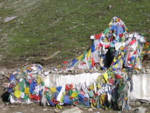 Buddhist prayer flags start appearing along the road (courtesy Gijs Remmelts)
