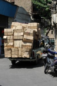 a stacked Paykan pick-up provides for freight transport