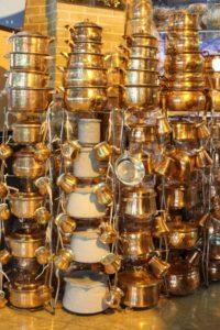copper ware displayed in the bazaar
