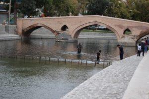 men fishing inside the mud in front of the small Safavid Pol-e Ebrahiminad
