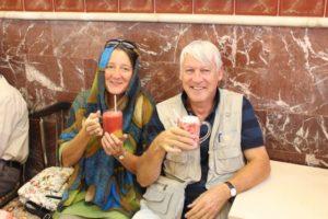 two tourists, also enjoying their fruit juice
