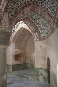decorated arches and green marble lower walls