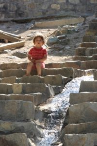 little girl on the stairs in Ushtebin village