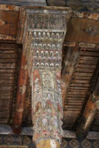 delicately decorated wooden pillar
