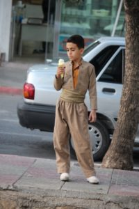 proud boy, in typical Kurdish suit