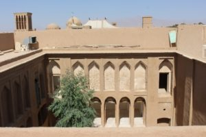 a courtyard seen from a roof: what else is hidden behind the high walls of Yazd?