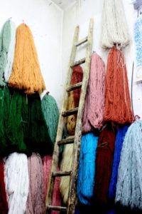 one of the merchandise is wool, in any colour