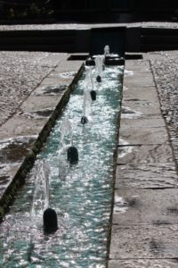 fountains and water flowing along one of the paths in Bagh-e Fin