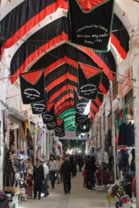 inside the covered bazaar, red and black dominate