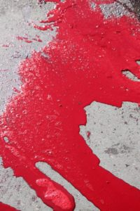 the result of a sheep slaughtered: the blood runs through the street