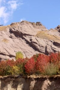 the Alamut Castle high up, behind the autumn colours