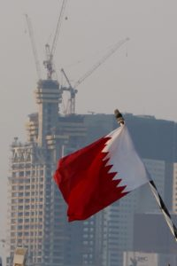 the flag of Qatar, in front of ongoing construction