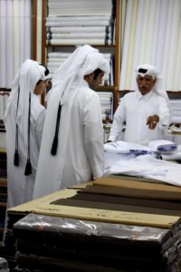 materials shop in the souq, selling white cloths